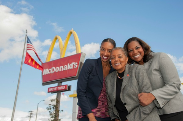 black franchise owners standing in front of McDonalds