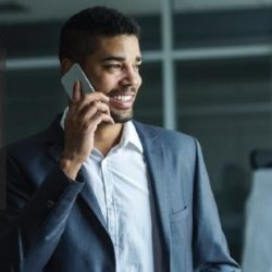Man talking with boss on his cell phone