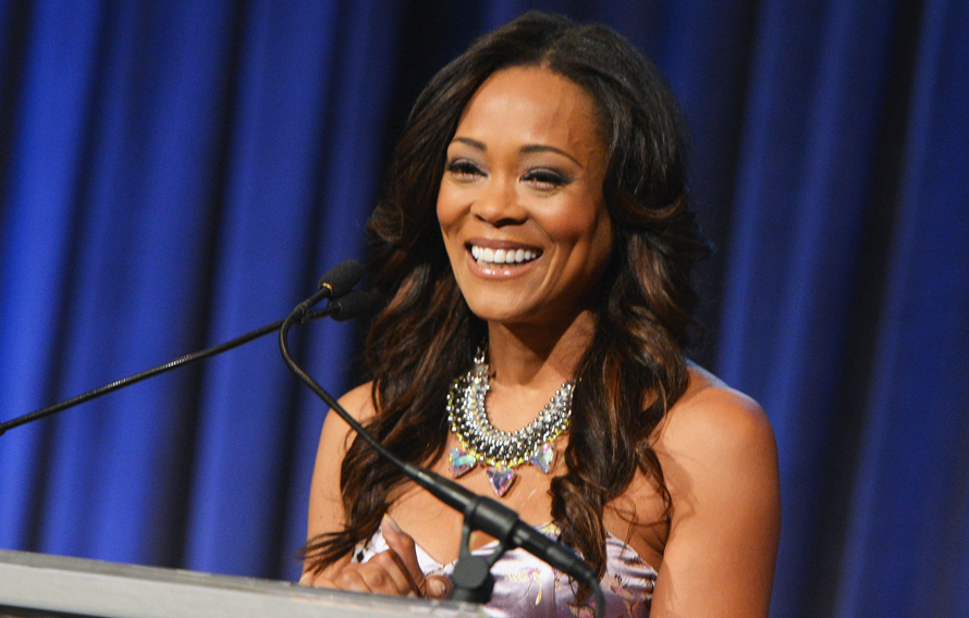 Robin Givens, star of the series Riverdale is pictured standing at a podim speaking to an audience