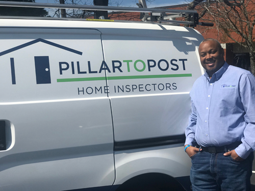 Demetrius Payne posing in front of his Home Inspection van
