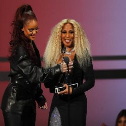 Rihanna presents Mary J. Blige with award on stage at the BET Awards Show