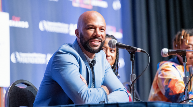 Common speaking at the Black Caucus meeting