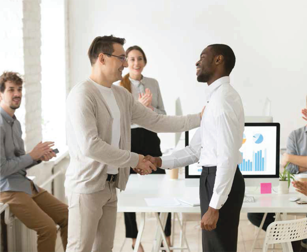 two men shaking hands in the office
