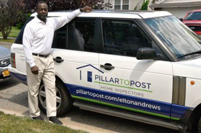 Elton Andrews stans next to his work vehicle