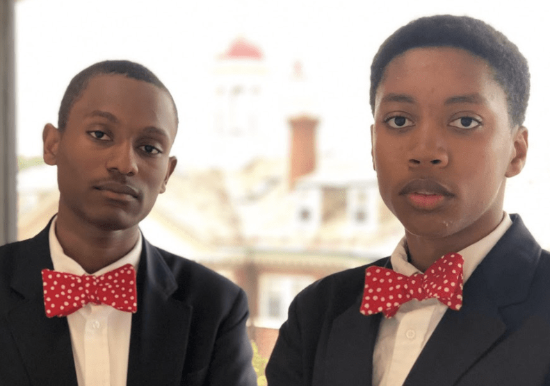 Atlanta high school debate team dressed in suits and red bow tiesstudents