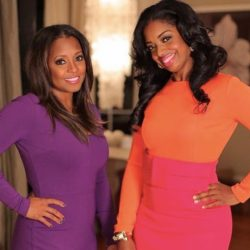 Keisha Night Pulliam and Arian Simone pose together in brightly colored dresses