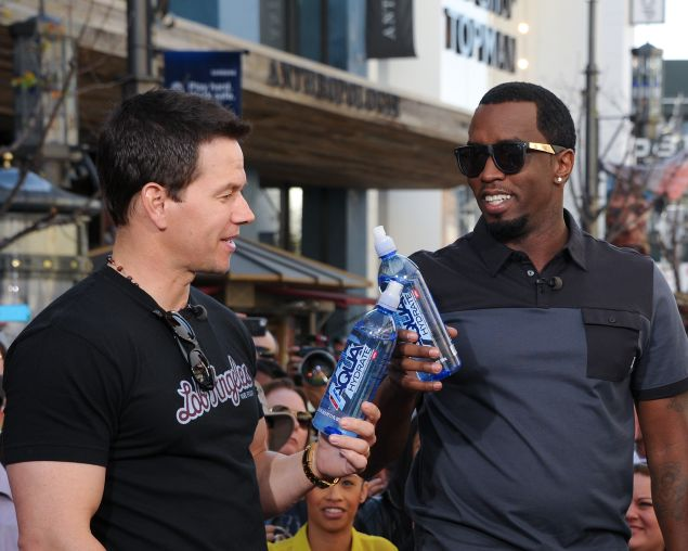 Mark Wahlberg (L) and Sean Combs visit Extra at The Grove holding their water bottles