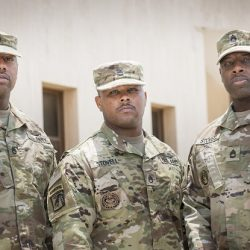 Three Stovell brothers pose for photo at their training site in Saudi Arabia, 26 June 2019. From left to right: Staff Sgt. Daniel Stovell, Staff Sgt. Daryl Stovell, and Sgt.1st Class Davin Stovell. All three work as training instructors for the U.S. Army Security Assistance Command's Military Assistance Group that advises the Saudi Ministry of Interior. Called MOI-MAG, the DoD program teaches Saudi security forces how to defend their country's critical infrastructure sites like ports, airports, bridges, oil pipeline and refineries. (U.S. Army photo by Richard Bumgardner)