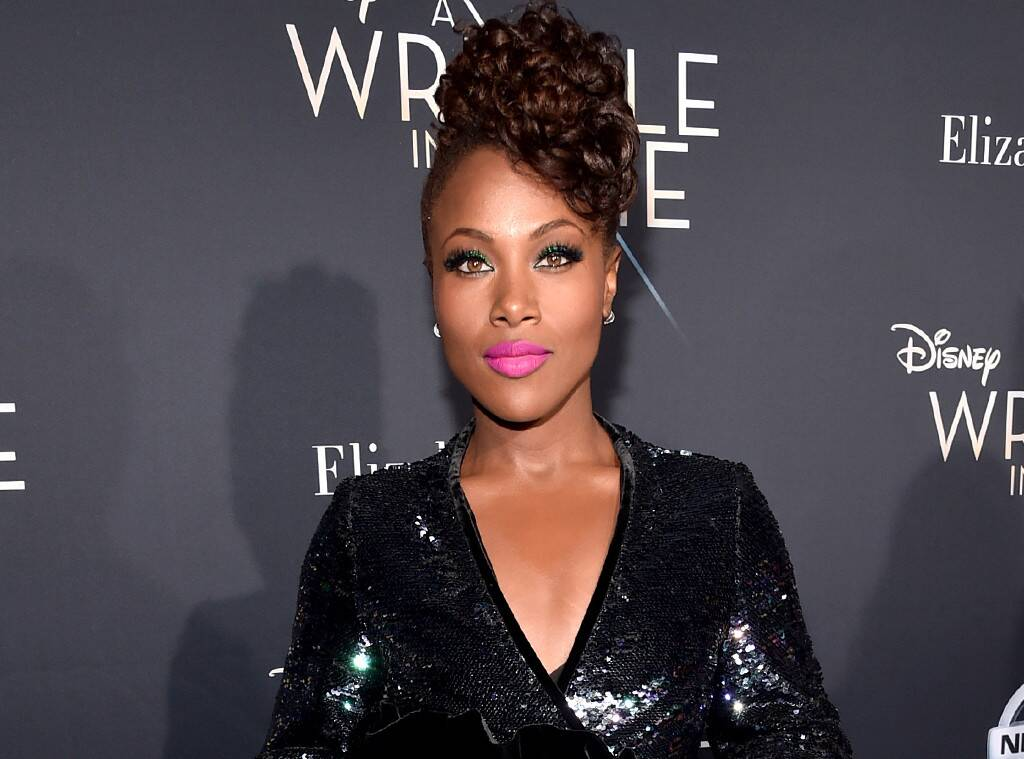 DeWanda Wise pictured at movie screeing with hair pinned up and wearing shiny black dress