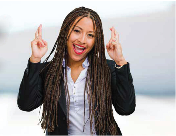 black professional woman smiling and crossing her fingers