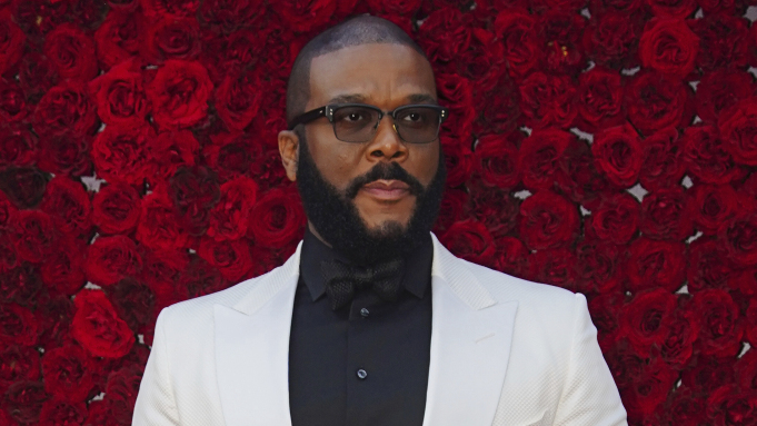 Tyler Perry poses for a photo on the red carpet at the grand opening of Tyler Perry Studios at Tyler Perry Studios