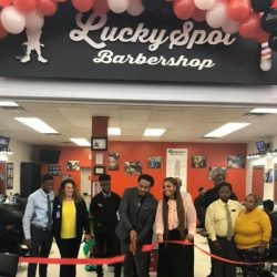 Entrepreneur Shaun Corbett cuts the ribbon on Da Lucky Spot, Walmart's first Black-owned barbershop.
