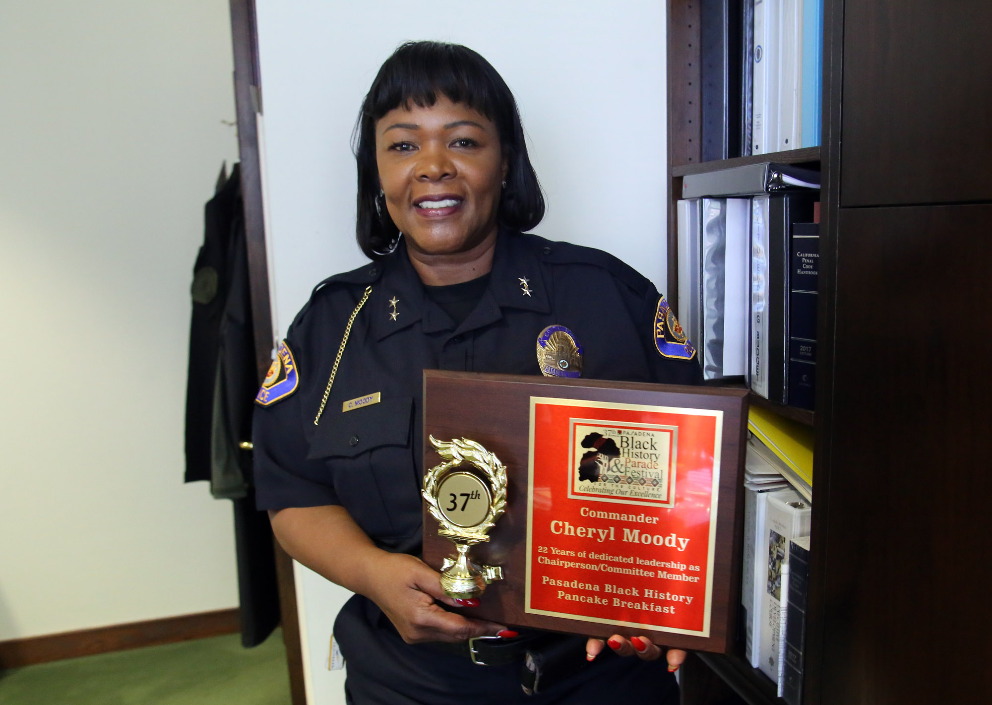 Commander Cheryl Moody from the Pasadena Police Department pose with an award she received during black history parade festival. Cheryl is one of the founding members of the San Gabriel Valley Chapter of the National Organization of Black Law Enforcement Executives (NOBLE) which started in 2003. Photo by James Carbone