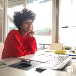 Smart cheerful woman working from home