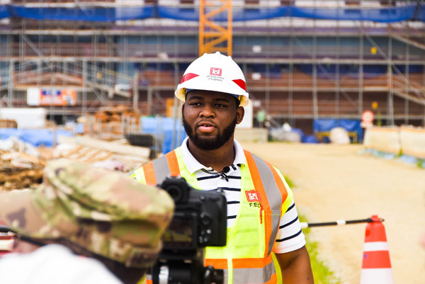 Samuel Coleman, a Tennessee State University senior civil engineering, wearing a hard hat inside a warehouse