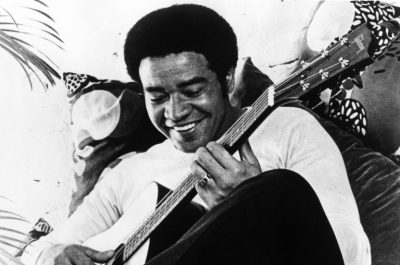 Bill Withers playing guitar