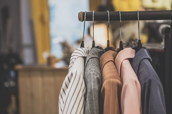 A clothes rack filled with women's coats